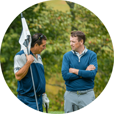 Two golfers talking on the green